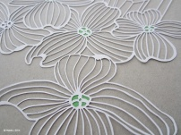 A Papercut of Dogwood and Trigger Crystal COLOR close up